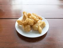 Chinese deep fried dough sticks in white dish famous breakfast in Thailand. Thai people called Pa tong ko. Chinese deep fried dough sticks in white dish famous Stock Photo