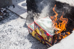 Chinese descendants burnt offering during annual QingMing festival. KUALA LUMPUR, MALAYSIA, April 2, 2016: Chinese descendants burnt offerings to ancestors Stock Photography