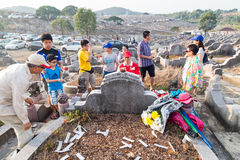 Chinese descendants clean and offer prayers to ancestors during annual Qing Ming festival. KUALA LUMPUR, MALAYSIA, April 2, 2016: Chinese descendants cleaning Stock Image