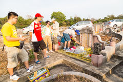 Chinese descendants clean and offer prayers to ancestors during annual Qing Ming festival Stock Photography