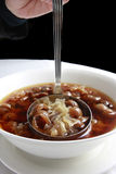 Chinese dessert, longan soup. Chinese traditional longan sweet soup with white jelly fungus Stock Images