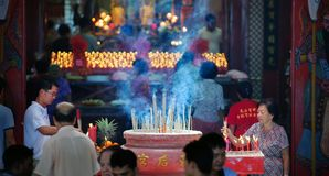 Chinese jobstick payers at Mazu Temple Malaysia. Chinese devotee burning jobsticks for praying at Terengganu Mazu Temple, Malaysia Royalty Free Stock Photography