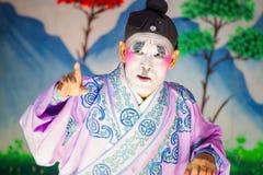 Chinese die opera voor een maan nieuwe jaarviering wordt uitgevoerd Stock Afbeelding