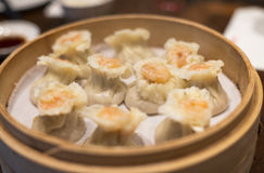 Chinese Dim Sum. Traditional Chinese prawn dim sum in a bamboo steamer stock image