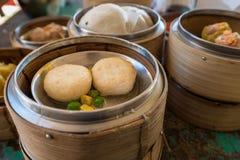 Chinese Dim sum in bamboo basket Stock Photos