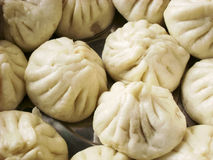 Chinese Steamed Buns. Baozi are steamed buns filled with ground meat and cabbage royalty free stock photography