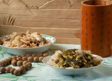 Chinese dining dishes. And antique. Pickles stir fried with pork and dried turnip stir fried with pork Stock Images