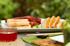 Chinese dining outdoors. Assorted chinese appetisers al fresco Stock Images
