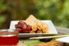 Chinese dining outdoors. Assorted chinese appetisers al fresco Royalty Free Stock Photos