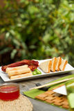 Chinese dining outdoors. Assorted chinese appetisers al fresco Royalty Free Stock Images