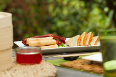 Chinese dining outdoors. Assorted chinese appetisers al fresco Stock Photo