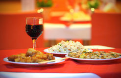 Chinese dinner with 3 dishes and wine glass Stock Photos