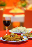 Chinese dinner at the restaurant. Presented in a typical manner and with a wine glass at the side Stock Images