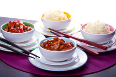 Chinese dinner with rice and chicken. Chinese bowls with rice and sweet & sour chicken Stock Images