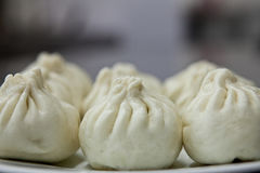 Chinese dish - Baozi. Steamed buns, called Baozi in Chinese, are a very popular asian. They can be stuffed with various ingredients Stock Image