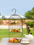 Chinese-dish cakes and pies put in birdcage Stock Photo