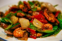 Chinese dish fried vegetables with shrimps in a sweet sauce, served on a white plate. Beijing, China. royalty free stock images