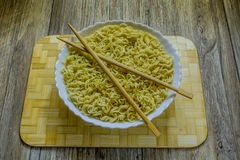 Chinese dish of noodles and chopsticks Royalty Free Stock Photography