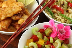 Chinese dishes. Three types of chinese dishes- noddles, salad and fish Royalty Free Stock Images