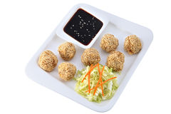 Chinese dishes, chicken balls with sesame seeds, Isolated on whi. Asian cuisine, Chinese dishes, a set of balls sesame seeds chicken with a salad of fresh Stock Images