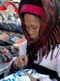 Chinese Diversity. One Chinese minority woman doing her needlework in home