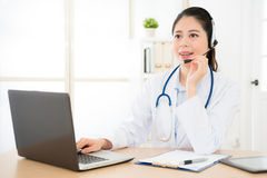 Chinese doctor having online phone call Royalty Free Stock Photography