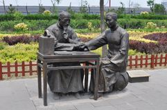 Chinese doctor and patient statues stock photo