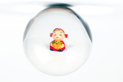 Chinese doll through glass spear. Cny on white background Royalty Free Stock Image
