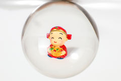 Chinese doll through glass spear. Cny on white background Royalty Free Stock Images