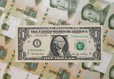 Chinese Dominance - USD-Yuan I. These are the smallest American and Chinese banknotes - with Yuan dominance like in the real monetary life Royalty Free Stock Photo