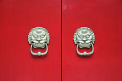 Chinese door with gate keeper Royalty Free Stock Images