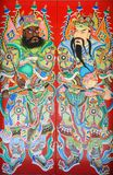 Chinese door god. This is a very traditional kind of house gates in China, which painted the ancient generals on the two sides of the gate. They are called door Stock Photos