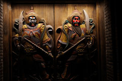 Chinese door god embossments. Chinese door gods with changeable faces,at Chengdu,China Stock Images