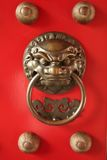 Chinese Door Guardian Handle for Protection. Traditional door knob with a lion guardian carving as a handle royalty free stock images