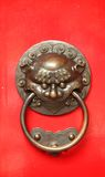 Chinese Door Handle With a Lion Guardian. Aggressive door protector found on traditional chinese doors stock photos
