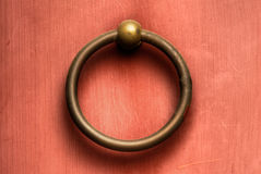 Chinese door knob. Chinese traditional circle bronze door knob on wall Stock Image