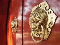 Chinese Door Knocker. Traditional Chinese door knockers at one of the many buildings at the Yuanmingyuan Park, Beijing, China Stock Image
