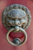 Chinese door knocker or handle. Antique chinese iron door knocker and handle Royalty Free Stock Image