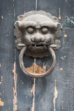 Chinese door knocker. An old Chinese door knocker with a lion face stock photo