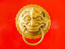 Chinese door knocker on red door background Stock Images