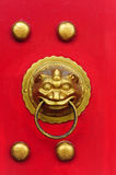 Chinese door with a lion hand door Royalty Free Stock Image
