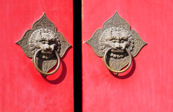 Chinese door with statues Stock Photos