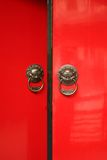 Chinese Door way with Handles and Gargoyles. Tradtional asian doors opening with its protective gargoyles which also serve as knockers and handles royalty free stock photography