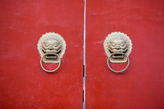 Chinese Door way with Handles and Gargoyles Stock Images