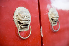Chinese Door way with Handles and Gargoyles Stock Photos