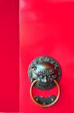 Chinese Doorknob. Traditional Chinese door design - painted in traditional Chinese red paint. During the olden days Chinese people paint there doors red Royalty Free Stock Images