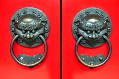 Chinese Doorknob. Traditional Chinese door design - painted in traditional Chinese red paint. During the olden days Chinese people paint there doors red Stock Image