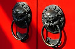 Chinese Doorknob. Traditional Chinese door design - painted in traditional Chinese red paint. During the olden days Chinese people paint there doors red Royalty Free Stock Photos
