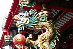 Chinese dragon. Dragon Statue by measuring pole Stock Image
