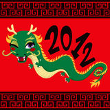 Chinese Dragon. Cute green dragon greeting 2012 chinese new year celebration on red background Royalty Free Stock Image